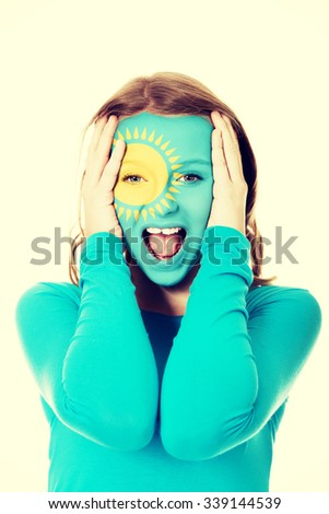 Woman with Kazakhstan flag painted on face. - stock photo