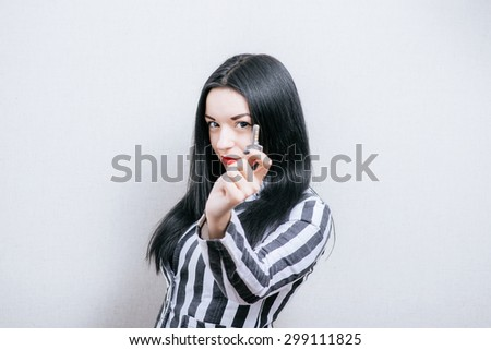 Woman with keys. On a gray background. - stock photo