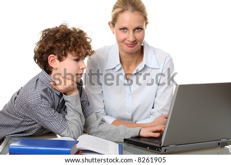Woman with kid at the laptop
