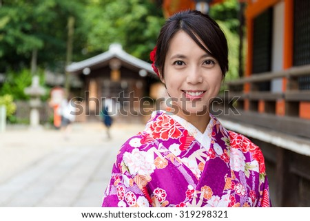Woman with kimono dress in the temple of Kyoto - stock photo