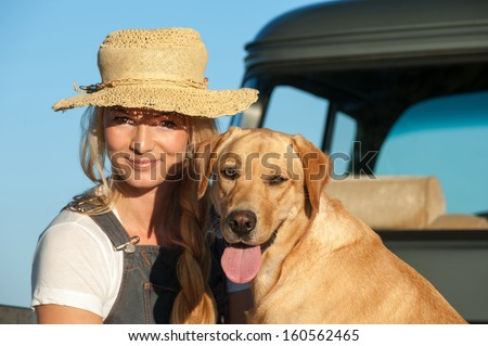 Woman with labrador retriever dog - stock photo
