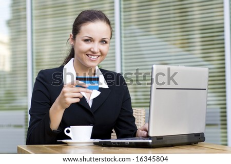 Woman with laptop and credit card - stock photo