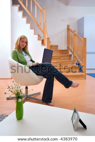 woman with laptop at home - stock photo