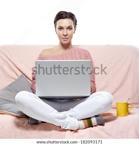woman with laptop sitting on the sofa. On white background