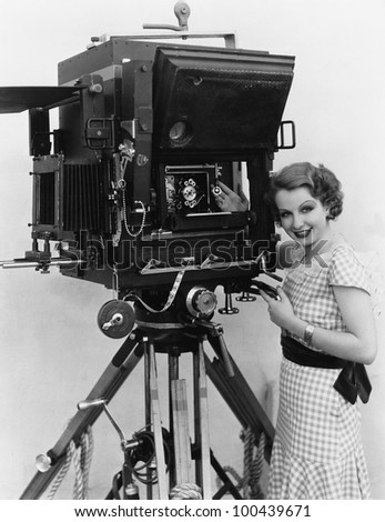 Woman with large camera - stock photo