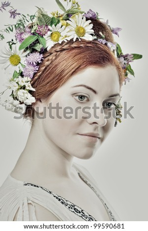 woman with large hairstyle and flowers in her hair. - stock photo