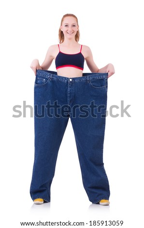 Woman with large jeans in dieting concept - stock photo