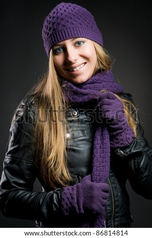 woman with leatherjacket, cap, gloves and scarf - stock photo