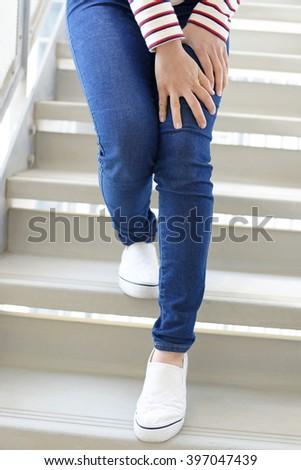 Woman with leg pain - stock photo