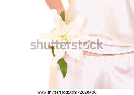 woman with lily isolated on white - body care - stock photo