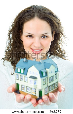 woman with little house in hand om white background