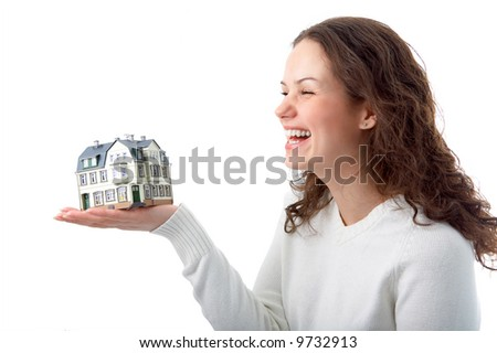 woman with little house on hand over white background