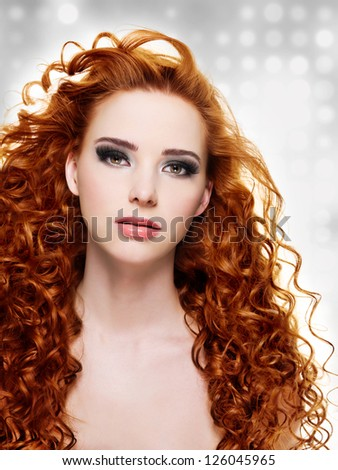 Woman with  long curly hairs and stylish purple make-up.  Blinking Background - stock photo