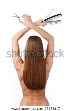 woman with long hair and barber's tools in her hands - stock photo