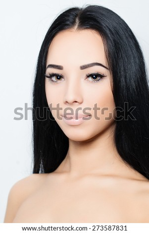 Woman with long hair and makeup - stock photo