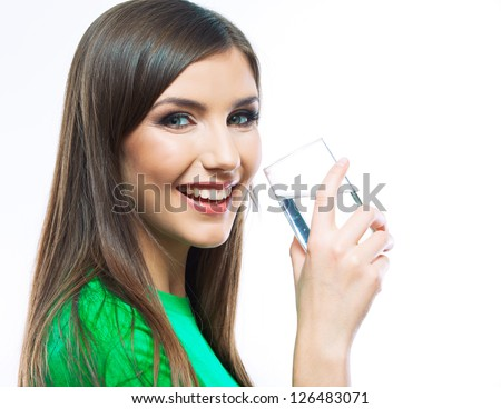 Woman with long hair hold water glass standing against white background - stock photo