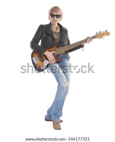 Woman with long legs playing guitar, wearing torn blue jeans and sunglasses, standing, looking at camera. Isolated on white - stock photo