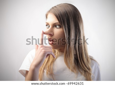 Woman with long nose - stock photo