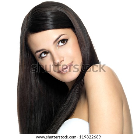 Woman with long straight hair. Fashion model looking up