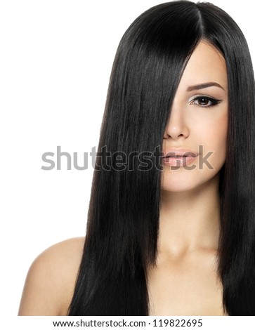 Woman with long straight hair. Fashion model posing at studio. - stock photo