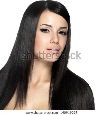 Woman with long straight hair. Fashion model posing at studio. - stock photo