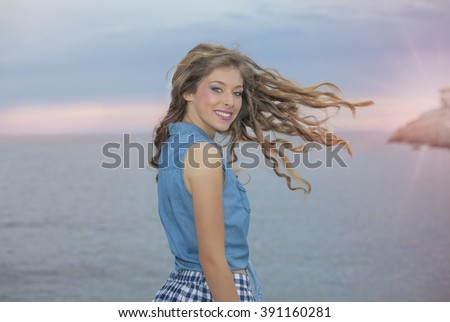 woman with long wavy healthy hair on vacation - stock photo