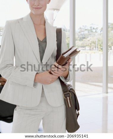 woman with lots of books - stock photo