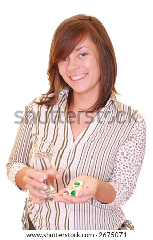 woman with lots of pills and glass of water isolated on white - stock photo