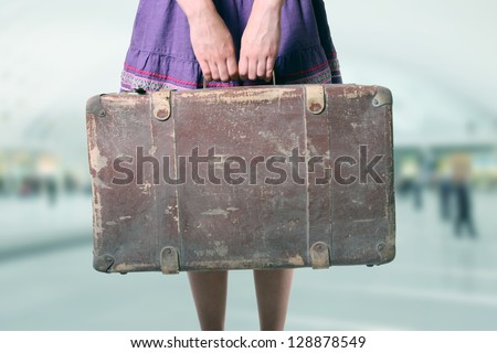 woman with luggage at the airport - stock photo