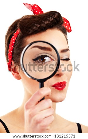 Woman with magnifier on white background - stock photo