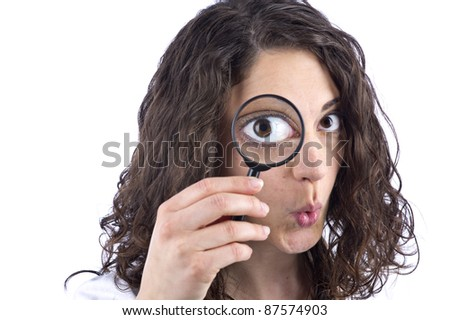 Woman with magnifying glass in front of the face