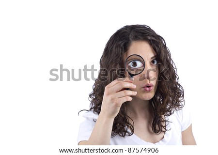 Woman with magnifying glass in front of the face - stock photo