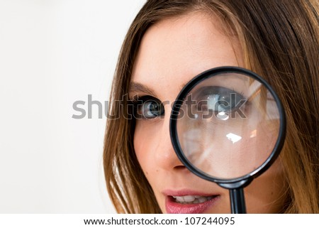 woman with magnifying glass on a white background - stock photo