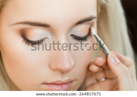 Woman with makeup brush. Stylist. make up brush - stock photo