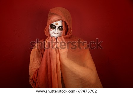 Woman with makeup for Day of the Dead covered with a scarf