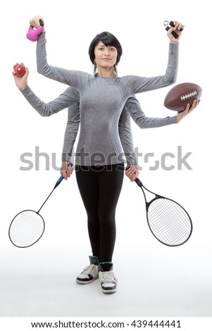 woman with many arms holding different sports objects in each hand - stock photo