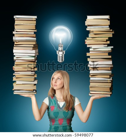woman with many books in her hands and bulb - stock photo