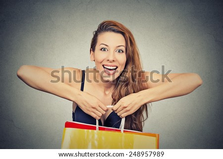 woman with many shopping bags on gray background - stock photo