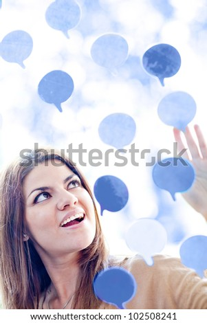 Woman with many thought bubbles - communication concepts - stock photo
