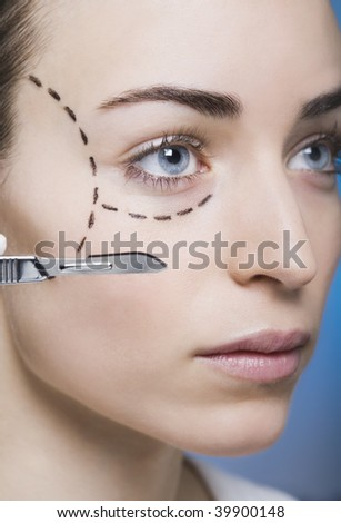 woman with marks on her face gets surgery - stock photo