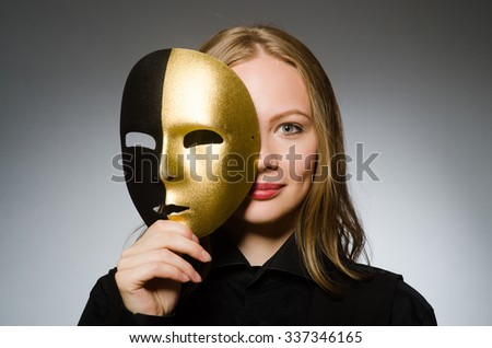 Woman with mask in funny concept - stock photo