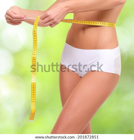 woman with measure tape - stock photo
