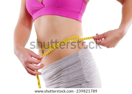 woman with measure tape - successful diet - stock photo