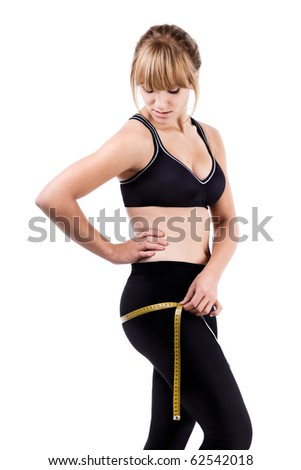 Woman with measuring tapelooking for lose weight isolated on white - stock photo