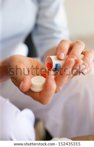 Woman with medication - stock photo
