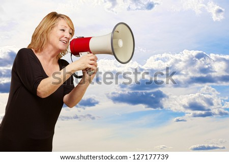 Woman with megaphone, outdoor
