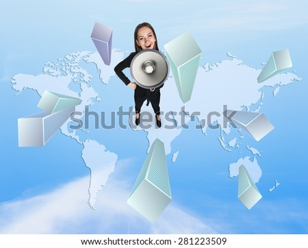 Woman with megaphone standing on the map - stock photo