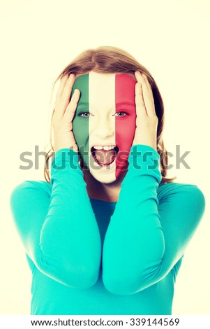 Woman with Mexico flag painted on face. - stock photo
