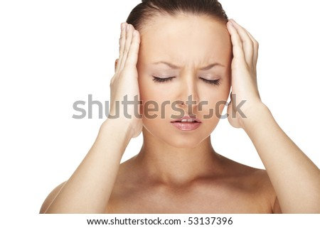 Woman with Migraine Headache holding hands to head - stock photo