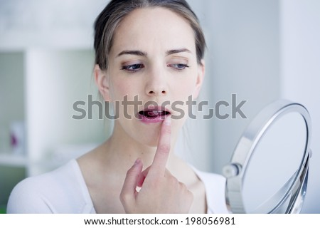 Woman with mirror - stock photo
